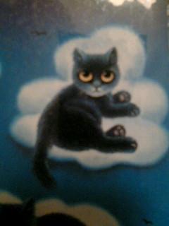 雲の上の黒猫